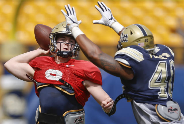 Pittsburgh quarterback Kenny Pickett (8) passes under pressure by defensive lineman James Folston Jr. (40) during their annual NCAA intrasquad college football spring Blue Gold game, Saturday, April 14, 2018, in Pittsburgh. The Blue team won 10-3. (AP Photo/Keith Srakocic)