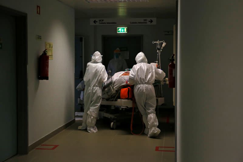 A patient is carried to the COVID-19 Intensive Care Unit (ICU) of Cascais Hospital, amid the coronavirus disease (COVID-19) pandemic in Cascais