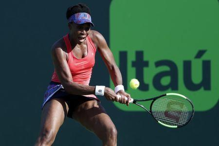 Mar 26, 2018; Key Biscayne, FL, USA; Venus Williams of the United States hits a backhand against Johanna Konta of Great Britain (not pictured) on day seven of the Miami Open at Tennis Center at Crandon Park. Williams won 5-7, 6-1, 6-2. Mandatory Credit: Geoff Burke-USA TODAY Sports