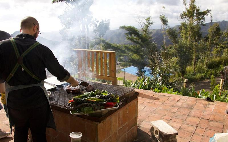 A chef works the grill during a pop-up dinner event. | Hernan F. Rodriguez