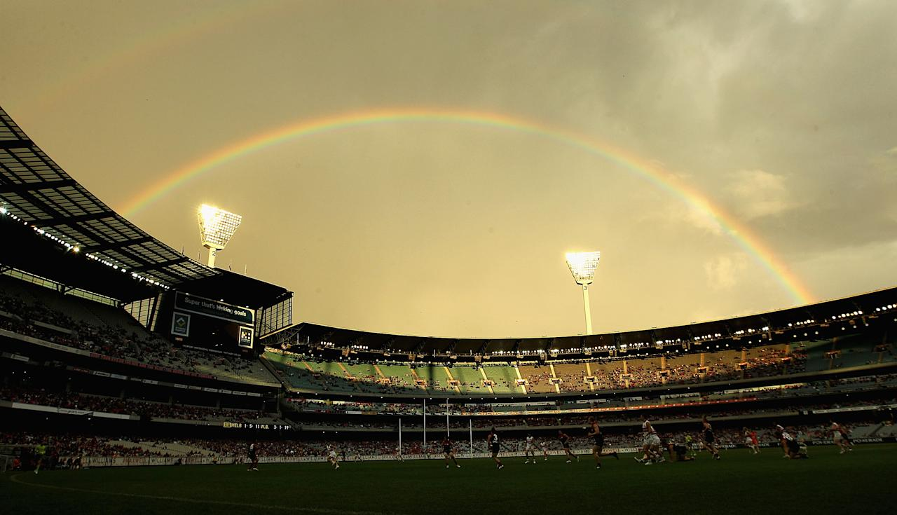 MELBOURNE, AUSTRALIA - APRIL 22:  Play takes place under a rainbow during the round four AFL match between the Melbourne Demons and the Western Bulldogs at Melbourne Cricket Ground on April 22, 2012 in Melbourne, Australia.  (Photo by Hamish Blair/Getty Images)