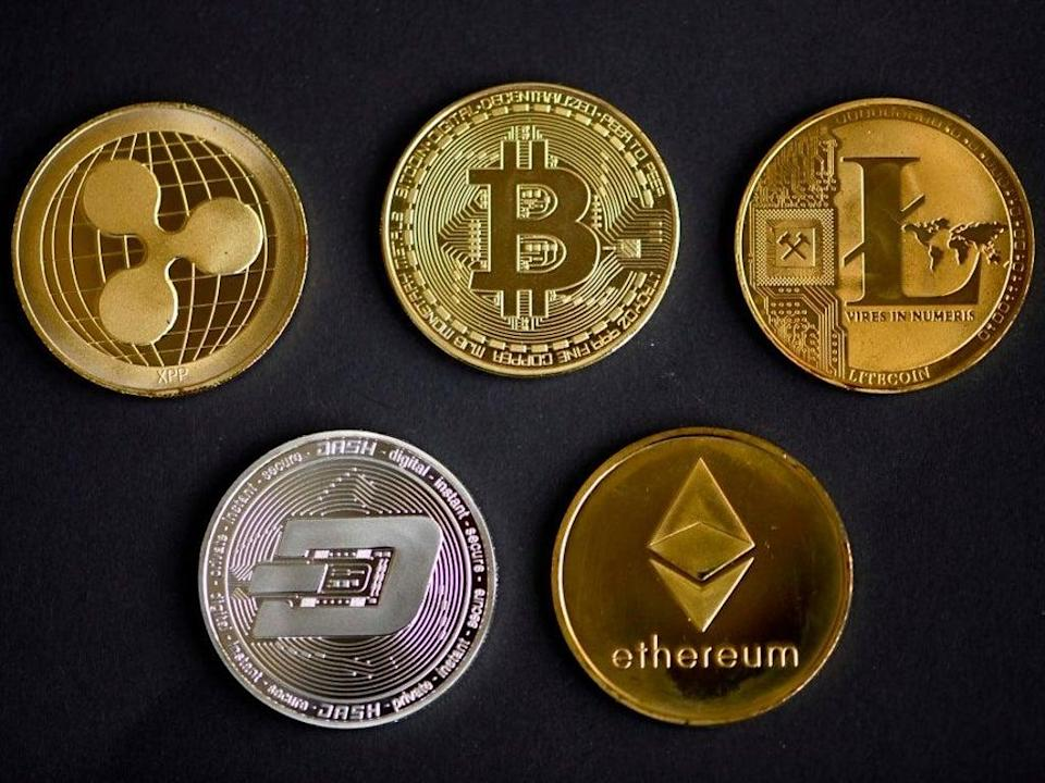 A market-wide cryptocurrency price crash in May has left many wondering whether it will recover (AFP via Getty Images)