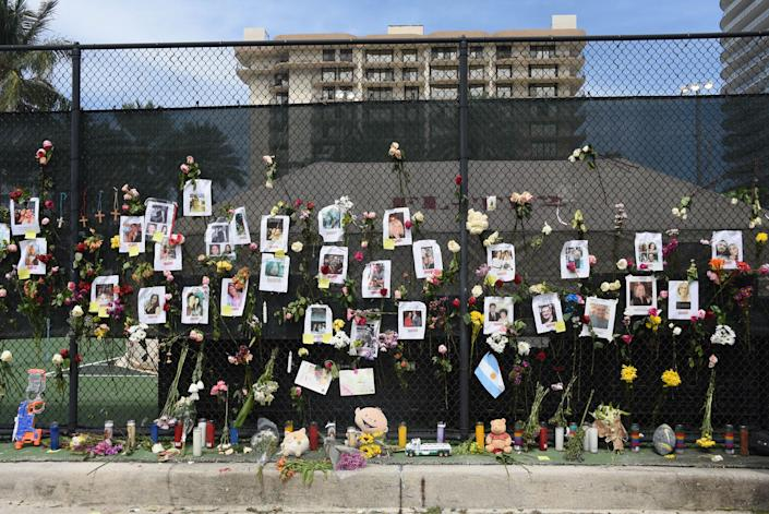 """Posters of missing loved ones hang on a fence on a nearby tennis court in Surfside on June 26.<span class=""""copyright"""">Michele Eve Sandberg—Shutterstock</span>"""