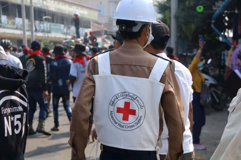 A member of Red Cross walks amid protests against the military coup in Dawei
