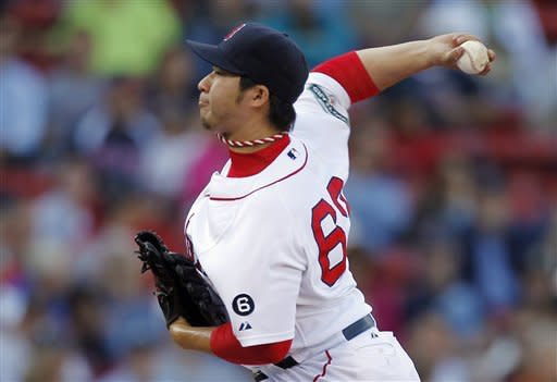 Boston Red Sox's Junichi Tazawa, of Japan, pitches in the ninth inning of a baseball game against the Baltimore Orioles in Boston, Saturday, Sept. 22, 2012. (AP Photo/Michael Dwyer)