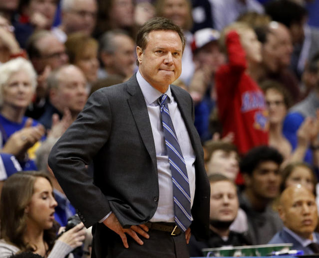 Kansas head coach Bill Self watches during the first half of an NCAA college basketball game against Oklahoma Wednesday, Jan. 2, 2019, in Lawrence, Kan. (AP Photo/Charlie Riedel)