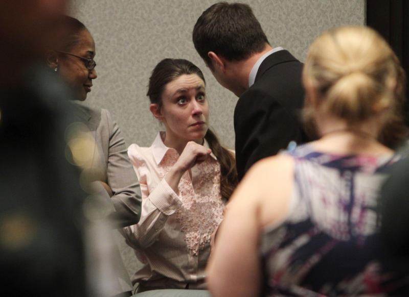 Casey Anthony talks with a supporter in court following the end of her  murder trial where she was acquitted of murder charges in  Orlando, Fla. Tuesday, July 5, 2011. Anthony had been charged with killing her daughter, Caylee.  (AP Photo/Red Huber, Pool)