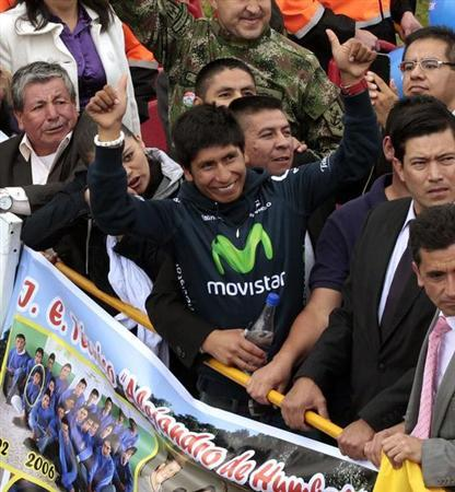 Colombian cyclist Quintana greets fans upon his arrival at Bogota Airport