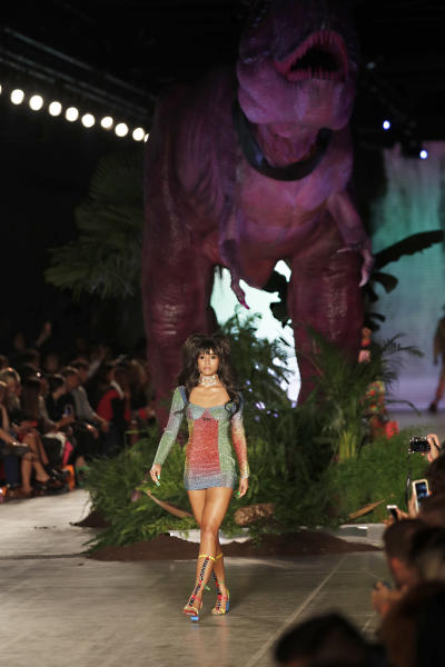 A model wears a creation as part of the GCDS Spring-Summer 2020 collection, unveiled during the fashion week, in Milan, Italy, Saturday, Sept. 21, 2019. (AP Photo/Antonio Calanni)