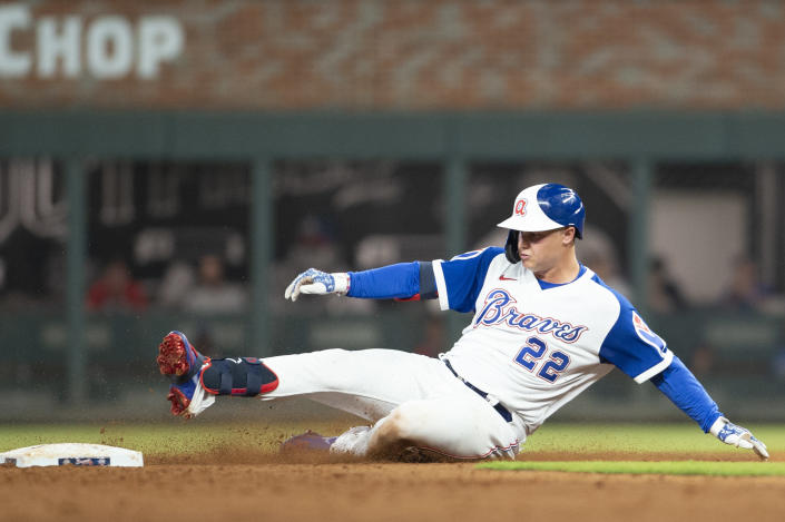 Joc Pederson slides into second base after hitting a double during the eighth inning of the team's baseball game against the Milwaukee Brewers. Saturday, July 31, 2021, in Atlanta. (AP Photo/Hakim Wright Sr.)