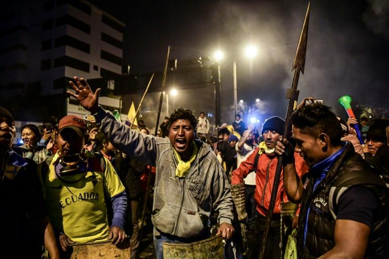 Indigenous people celebrate in Quito on October 13, 2019 after Ecuador's president and indigenous leaders reached an agreement to end violent protests