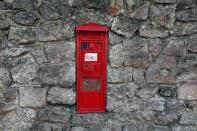 FILE PHOTO: A vintage red post box is seen in West Malling