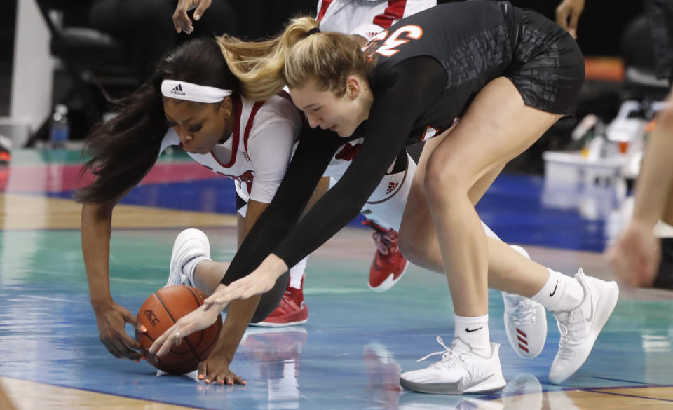 North Carolina State's Jada Boyd (5) and Virginia Tech's Elizabeth Kitley (33) go after a loose ball during the first half of an NCAA college basketball game in the Atlantic Coast Conference women's tournament in Greensboro, N.C., Friday, March 5, 2021. (Ethan Hyman/The News & Observer via AP)