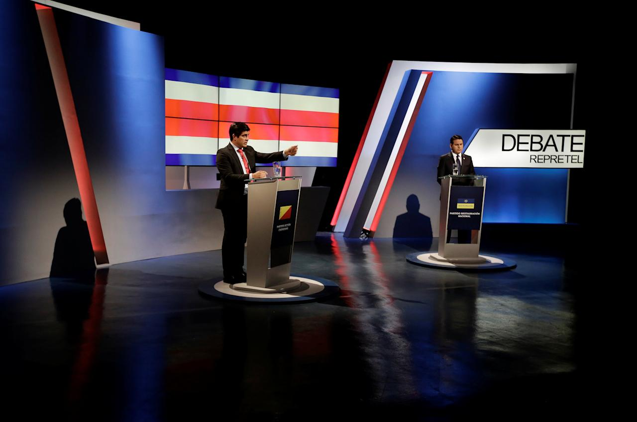 Carlos Alvarado (L), presidential candidate of the ruling Citizens' Action Party (PAC), and Fabricio Alvarado, presidential candidate of the National Restoration party (PRN), attend a live televised debate before a second-round presidential election runoff in San Jose, Costa Rica, March 22, 2018. REUTERS/Juan Carlos Ulate.