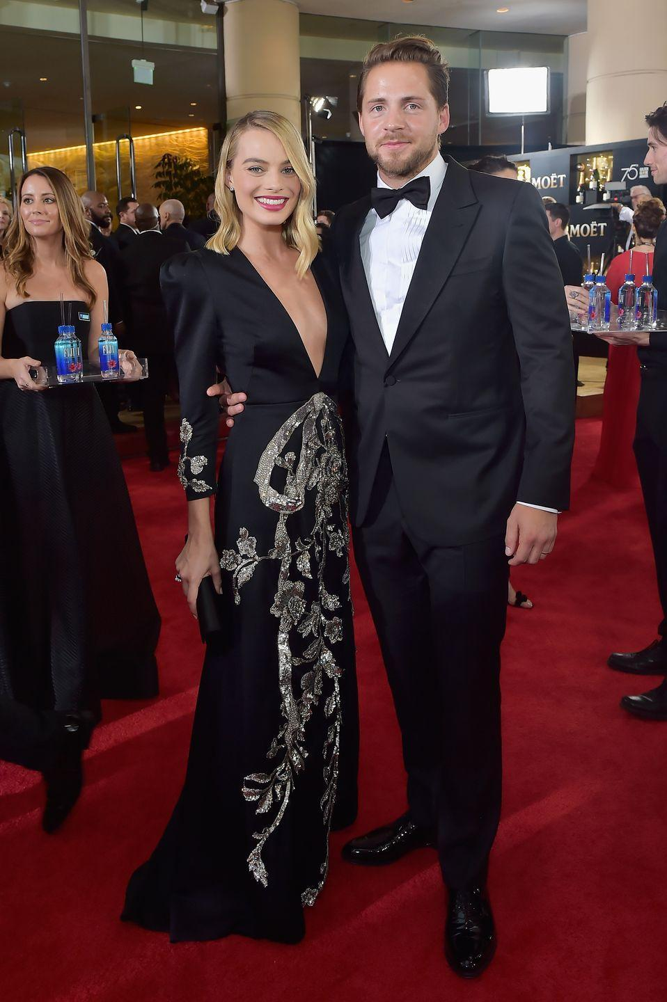 """<p>Margot Robbie and Tom Ackerley tied the knot in December 2016, but didn't make their first appearance as a couple until 2017. Ackerley is also in the film business, as an assistant director and producer. He founded the production company, <a href=""""https://www.elle.com/culture/celebrities/a30784625/who-is-tom-ackerley-margot-robbie-husband/"""" rel=""""nofollow noopener"""" target=""""_blank"""" data-ylk=""""slk:LuckyChap Entertainment"""" class=""""link rapid-noclick-resp"""">LuckyChap Entertainment</a>, with his wife in 2014.</p>"""
