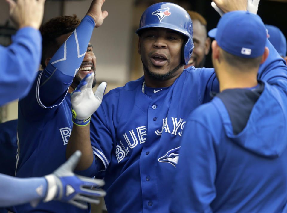 Toronto Blue Jays' Edwin Encarnacion is congratulated after hitting a home run off Oakland Athletics Kendall Graveman in the second inning of a baseball game Tuesday, July 21, 2015, in Oakland, Calif. (AP Photo/Ben Margot)