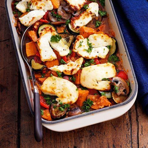 """<p>Roasting vegetables brings out their natural sweetness and adding lentils give this dish extra body.</p><p><strong>Recipe: <a href=""""https://www.goodhousekeeping.com/uk/food/recipes/a535470/roasted-vegetable-lentil-and-halloumi-bake/"""" rel=""""nofollow noopener"""" target=""""_blank"""" data-ylk=""""slk:Roasted Vegetable, Lentil and Halloumi Bake"""" class=""""link rapid-noclick-resp"""">Roasted Vegetable, Lentil and Halloumi Bake</a></strong></p>"""
