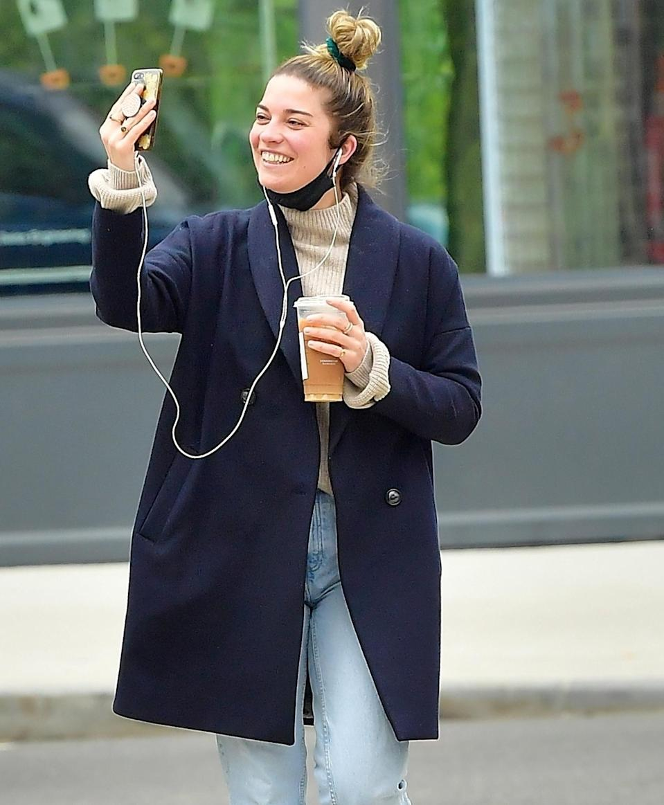 <p>Annie Murphy smiles while chatting on the phone on her walk through N.Y.C. on Wednesday.</p>