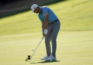 Sam Burns hits his second shot on the 18th hole during the first round of the Genesis Invitational golf tournament at Riviera Country Club, Thursday, Feb. 18, 2021, in the Pacific Palisades area of Los Angeles. (AP Photo/Ryan Kang)