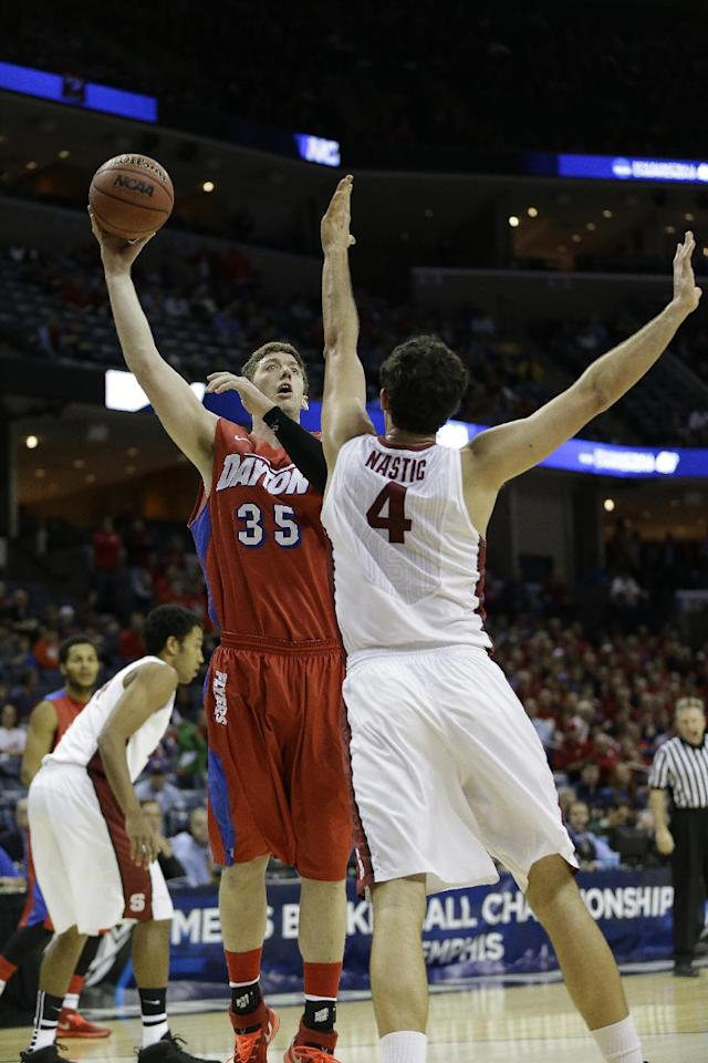 Dayton forward/center Matt Kavanaugh (35) shoots against Stanford center Stefan Nastic (4) during the first half in a regional semifinal game at the NCAA college basketball tournament, Thursday, March 27, 2014, in Memphis, Tenn. (AP Photo/Mark Humphrey)