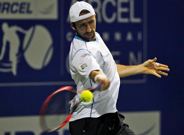 Benjamin Becker of Germany returns a shot to Stanislas Wawrinka of Switzerland during the second round of the ATP Chennai Open 2014 in Chennai, India, Wednesday, Jan. 1, 2014. Wawrinka won the match. (AP Photo/Arun Sankar K.)