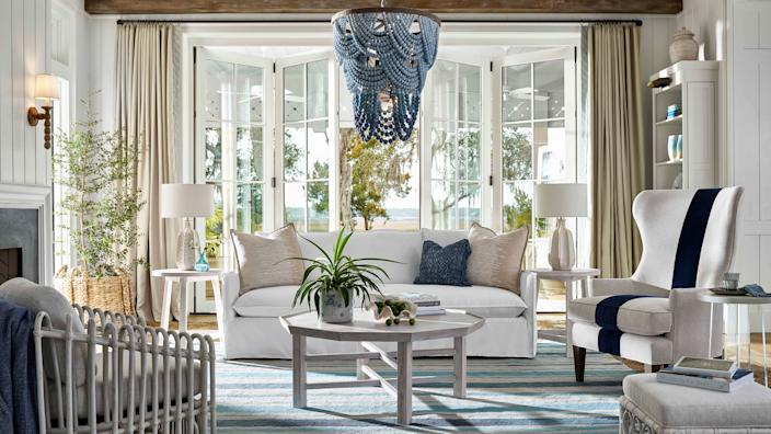 Universal's Coastal Living Collection brings the feel of a seaside retreat home with casual, cozy pieces and materials like wood and rattan that evoke a breezy feel.