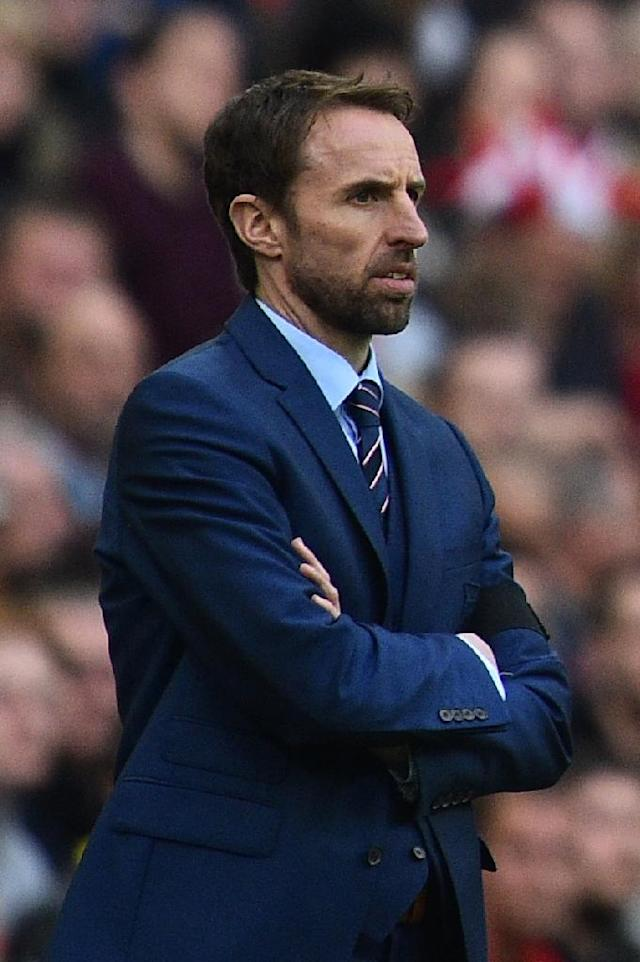 England's manager Gareth Southgate watches his players from the touchline during their Russia 2018 World Cup qualification match against Lithuania, at Wembley Stadium in London, on March 26, 2017 (AFP Photo/Glyn Kirk)