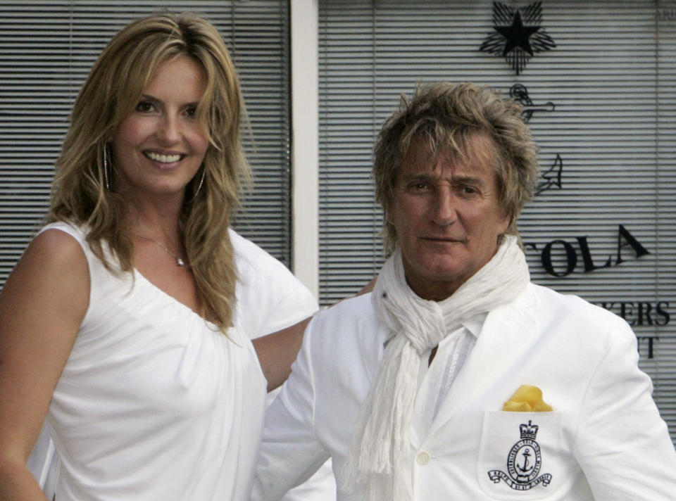 Rock singer Rod Stewart poses with his fiancee, model Penny Lancaster, in the northern Italian coastal town of Portofino June 15, 2007. Stewart's publicist confirmed this week to Reuters that the couple are to be married in the picturesque town on June 16. REUTERS/Dario Pignatelli    (ITALY)