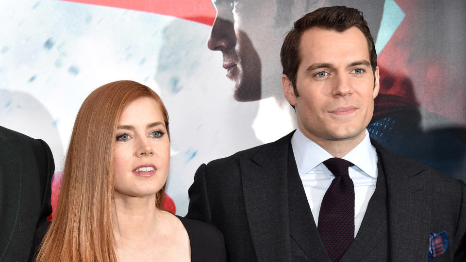 """Amy Adams and Henry Cavill at the """"Batman v Superman: Dawn of Justice"""" premiere on March 20, 2016. (Photo by Bryan Bedder/Getty Images for Bai Superteas)"""