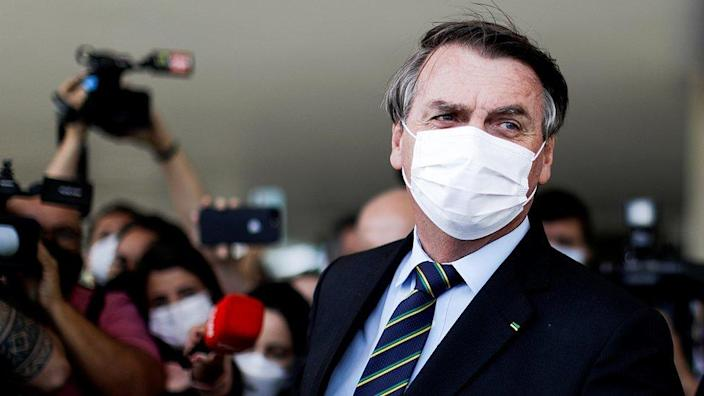 Brazilian President Jail Bolsonaro can be seen after meeting with Brazilian House of Representatives Arthur Lira at Planalto Palace in Brasilia on March 30, 2021.