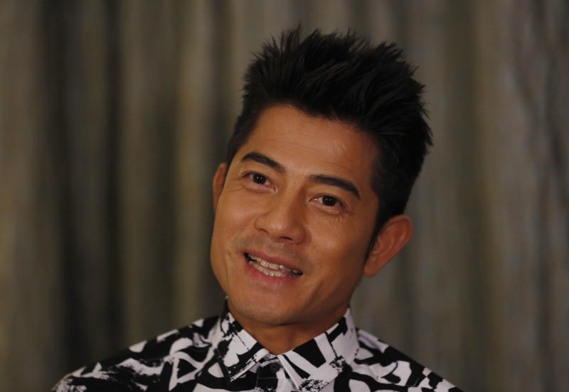 """In this Friday, Jan. 10, 2014 photo, Hong Kong veteran actor and performer Aaron Kwok speaks during an interview in Hong Kong. Kwok says he brought out a softer side of a classic villain, the Bull Demon King. Kwok plays the character in the new 3-D fantasy film, """"The Monkey King."""" He joins a stellar ensemble cast that includes other A-listers like Donnie Yen, Chow Yun Fat, and Kelly Chan. (AP Photo/Kin Cheung)"""