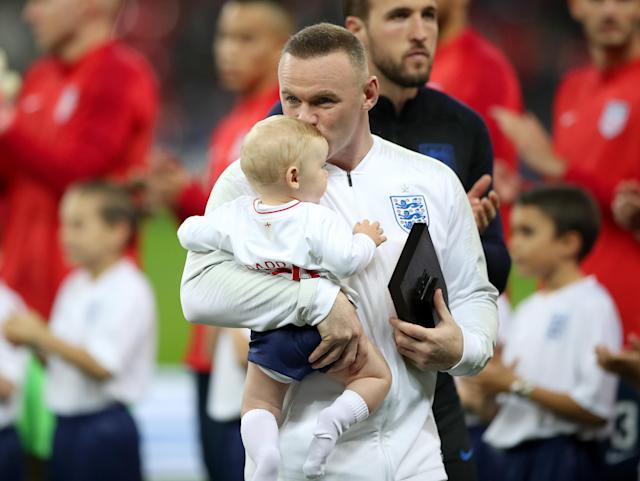 Rooney receives a plaque from Harry Kane (Nick Potts/PA)