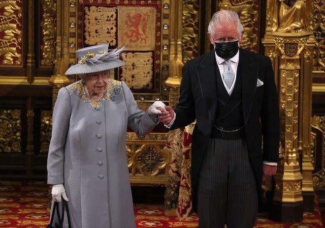 The Queen with Charles after she delivered the speech