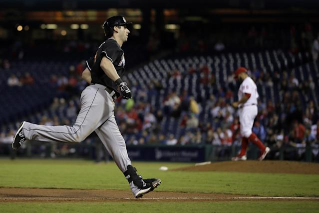 Miami Marlins' Ed Lucas, left, rounds the bases after hitting a home run off Philadelphia Phillies relief pitcher Cesar Jimenez during the 10th inning of a baseball game on Wednesday, Sept. 18, 2013, in Philadelphia. Miami won 4-3 in 10 innings. (AP Photo/Matt Slocum)