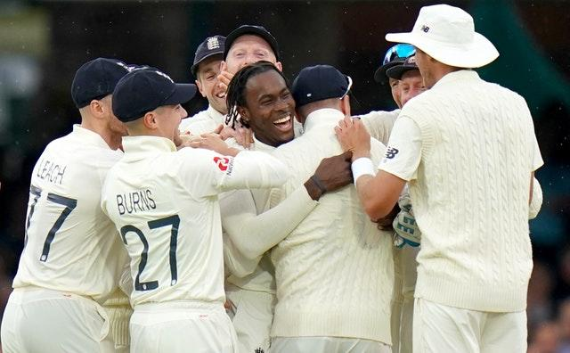 Jofra Archer, centre, was mobbed by his team-mates after dismissing Cameron Bancroft (John Walton/PA)