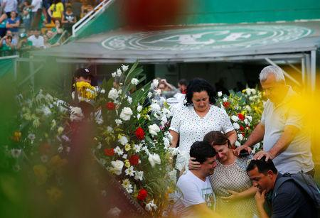 Relatives of players of Brazil's Chapecoense soccer team react before a ceremony mourning the victims after the plane carrying the team crashed in Colombia, at Arena Conda stadium in Chapeco, Brazil, December 2, 2016. REUTERS/Ricardo Moraes