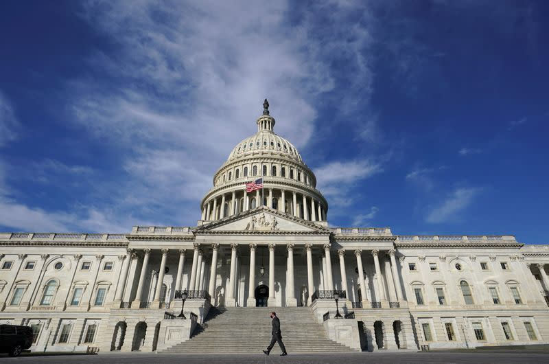 FILE PHOTO: A man walks past the U.S. Capitol in Washington