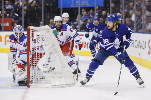 Toronto Maple Leafs right wing William Nylander (88) works the puck around the net and New York Rangers goaltender Alexandar Georgiev (40) during second-period NHL hockey game action in Toronto, Saturday, Dec. 28, 2019. (Cole Burston/The Canadian Press via AP)