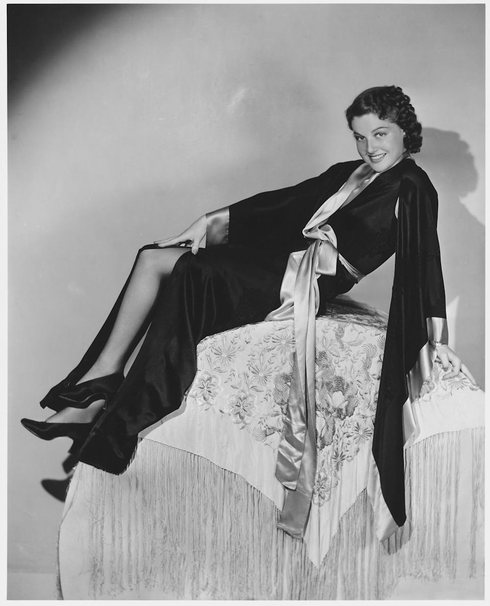 Sheridan poses in a black silk robe in this undated photo.