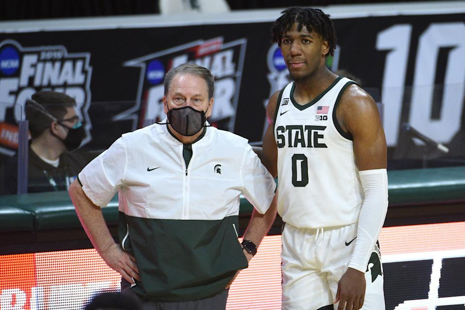 Michigan State coach Tom Izzo and forward Aaron Henry look on during the second half against the Indiana Hoosiers at Breslin Center, March 2, 2021.