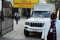 A van carries boxes of Covishield vaccine to different centres in Allahabad on January 15, 2021 with some 150,000 staff in 700 districts trained to administer the jabs across India