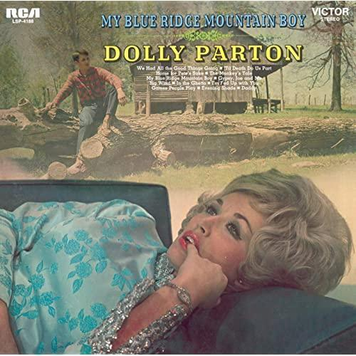 """The album cover of """"My Blue Ridge Mountain Boy"""" featuring Dolly Parton's husband Carl Dean in the background."""