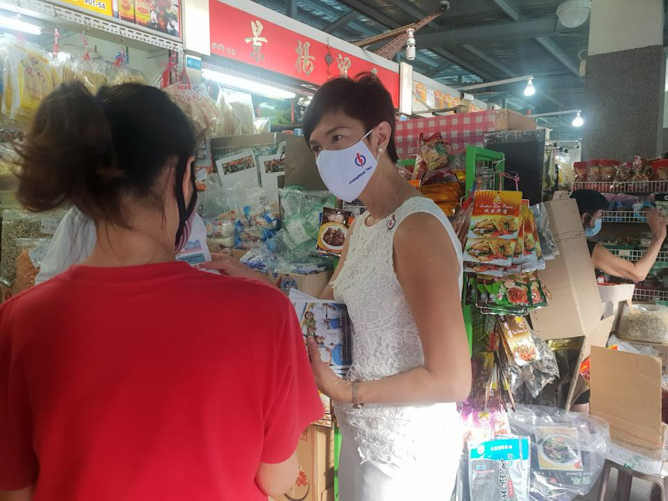 Manpower Minister and PAP candidate for Jalan Besar GRC Josephine Teo (right) on a walkabout at Blk 92 Whampoa Makan Place. (Photo: Wan Ting Koh)