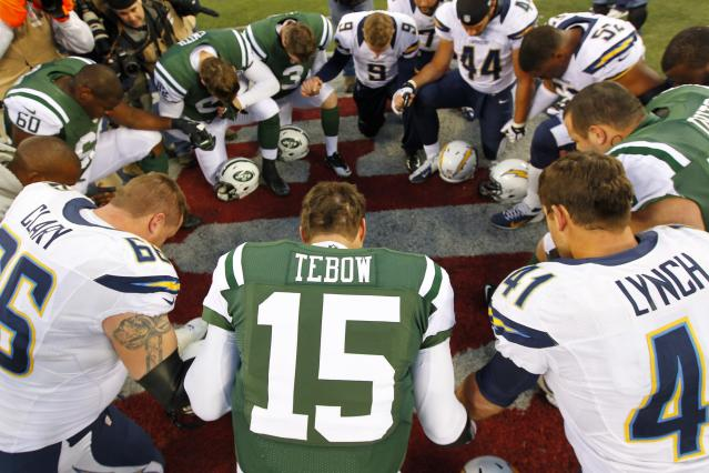 EAST RUTHERFORD, NJ - DECEMBER 23: Quarterback Tim Tebow #15 the New York Jets leads a players prayer after their game against the San Diego Chargers at MetLife Stadium on December 23, 2012 in East Rutherford, New Jersey. The Chargers defeated the Jets 27-17. (Photo by Rich Schultz /Getty Images)