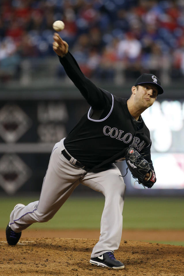 Colorado Rockies' Jordan Lyles pitches during the second inning of a baseball game against the Philadelphia Phillies, Wednesday, May 28, 2014, in Philadelphia. (AP Photo/Matt Slocum)