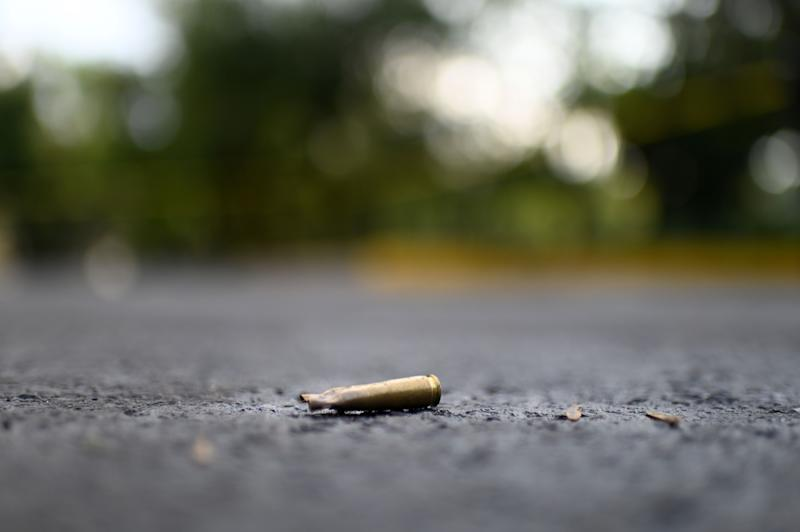 A bullet casket is seen on the ground at the crime scene after Mexico City's Public Security Secretary Omar Garcia Harfuch was wounded in an attacked in Mexico City, on June 26, 2020. (Photo by PEDRO PARDO / AFP) (Photo by PEDRO PARDO/AFP via Getty Images)