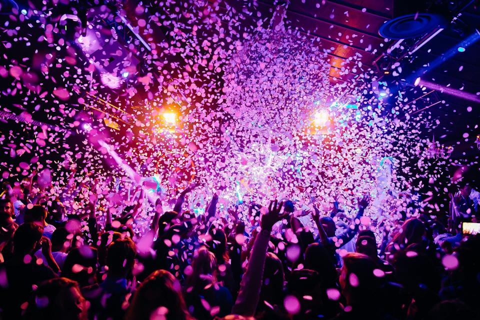 Concert crowd - picture with a lof of people dancing i a concert, night club with raised their hands up! Amazing colours! (Photo: TomasSimkus via Getty Images)