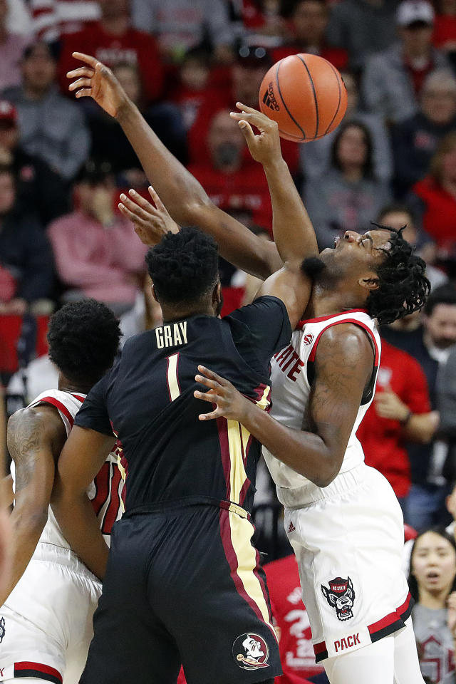 North Carolina State's DJ Funderburk (0) battles with Florida State's RaiQuan Gray (1) for the ball during the first half of an NCAA college basketball game in Raleigh, N.C., Saturday, Feb. 22, 2020. (AP Photo/Karl B DeBlaker)