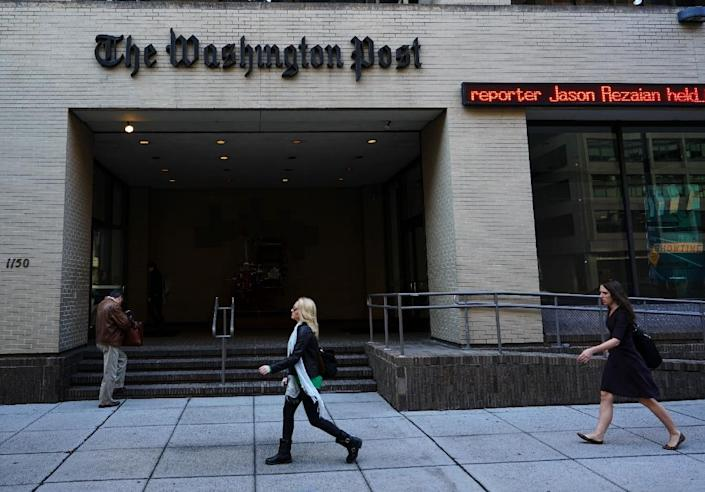 The Washington Post officially leaves its headquarters building in downtown Washington on December 14 as it migrates its 700-person newsroom staff three blocks away to offices designed as the newsroom of the future (AFP Photo/Mandel Ngan)