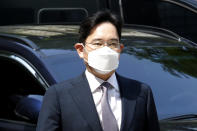 FILE - In this June 8, 2020 file photo, Samsung Electronics Vice Chairman Lee Jae-yong arrives at the Seoul Central District Court in Seoul, South Korea. As Samsung Electronics mourns the death of its long-time chairman, Lee Kun-Hee, questions loom over what's next for South Korea's biggest company. Samsung has struggled for years to diversify from its core hardware business to tap new technologies and services. (AP Photo/Ahn Young-joon, File)